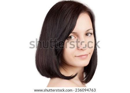 Close-up portrait of young beautiful woman with short hairstyle. Beautiful haircut. Short straight healthy hair. Skin care concept. - stock photo