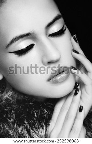 Close-up portrait of young beautiful woman with stylish cat eye make-up - stock photo