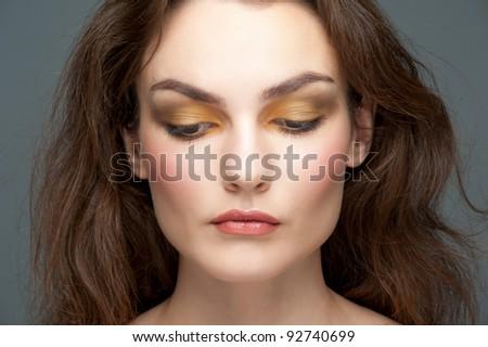 Close-up portrait of young beautiful woman with stylish make-up - stock photo