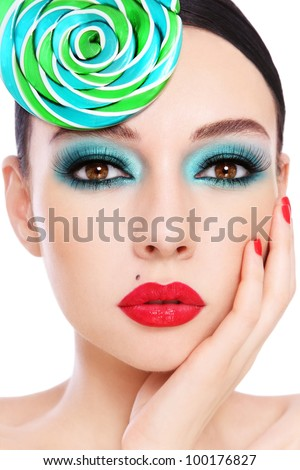 Close-up portrait of young beautiful woman with stylish make-up and fancy hat - stock photo