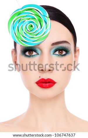 Close-up portrait of young beautiful woman with stylish make-up and fancy lollipop hat - stock photo