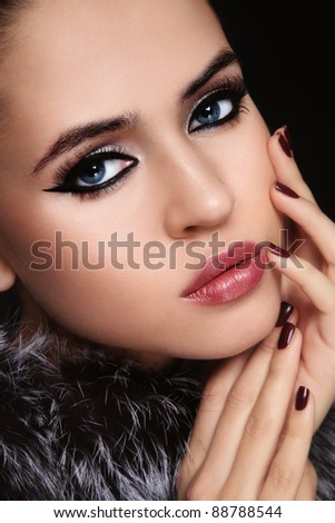 Close-up portrait of young beautiful woman with trendy make-up - stock photo