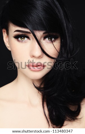 Close-up portrait of young beautiful woman with trendy make-up and hairstyle - stock photo