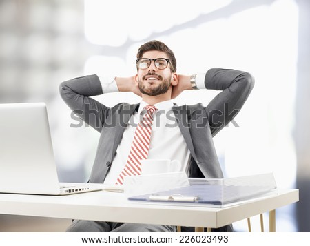 Close-up portrait of young broker relaxing and  leaning back at office. Business people. - stock photo