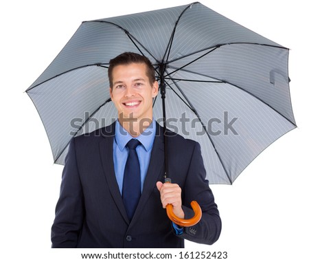 close up portrait of young business executive holding umbrella - stock photo