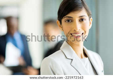 close up portrait of young businesswoman in office - stock photo
