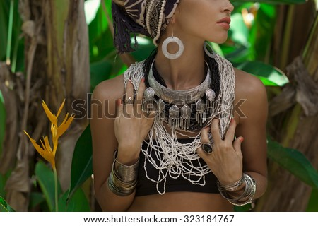 close up portrait of young caucasian woman with silver jewelry - stock photo