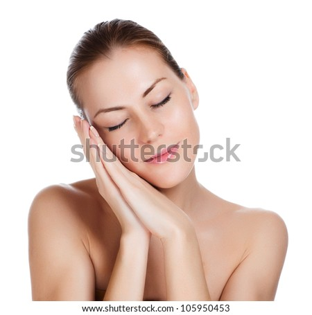 Close-up portrait of young closing eyes woman's face with clean fresh skin - close-up - stock photo