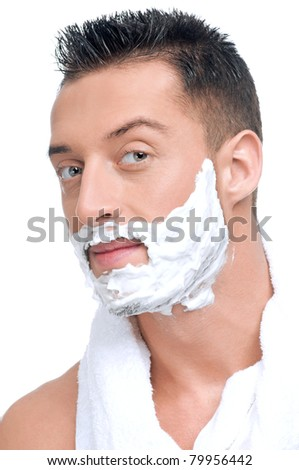 Close up portrait of young handsome man face with perfect skin in shaving foam. - stock photo