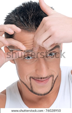 Close up portrait of young handsome man with perfect skin and hair. Tweezer eyebrow - stock photo