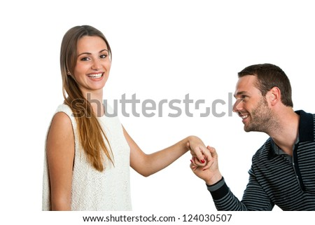 Close up portrait of young man proposing to his girlfriend. isolated on white. - stock photo