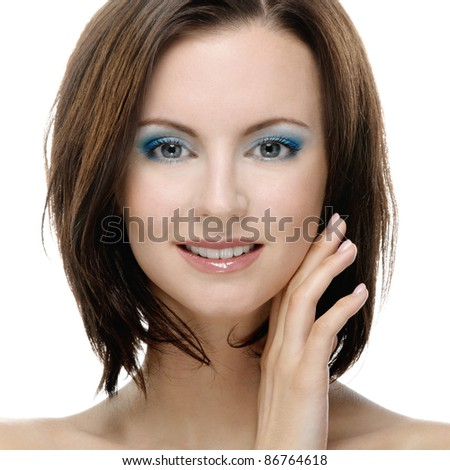 Close-up portrait of young smiling dark-haired woman against white background. - stock photo