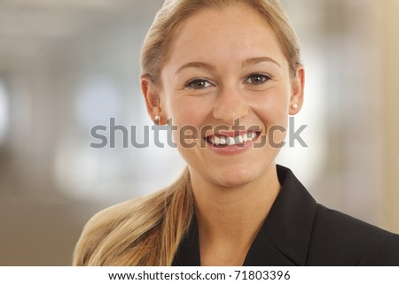 Close up portrait of young woman in business suit - stock photo