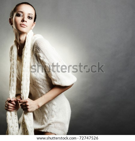 close up portrait of young woman in white sweater - stock photo