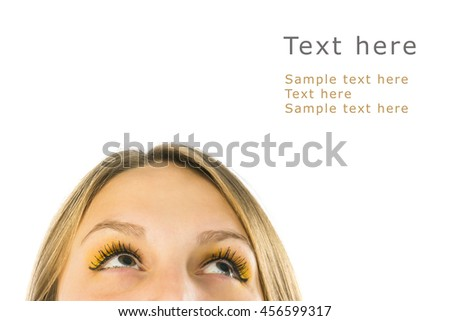 Close up portrait of young woman looking up with blank copy space, on white background - stock photo