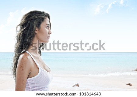 close up portrait of young woman walking through the empty  beach - stock photo