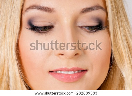 Close up portrait of young woman with beautiful eyes - stock photo