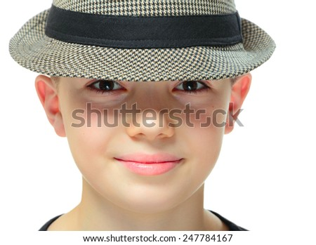 Close-up portrait on boy clothing a hat with shadow on his eyes, on white background - stock photo