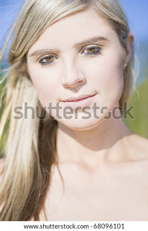 Close Up Portrait On The Face Of A Smiling Beautiful Woman Outdoors - stock photo