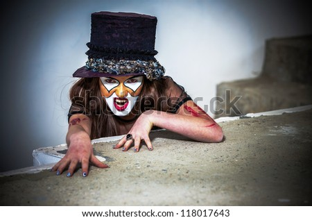 Close up portrait scary monster clown - stock photo