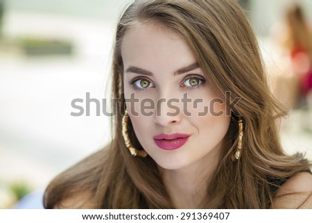 Close up Portrait, Young beautiful blonde woman posing outdoors in sunny weather - stock photo