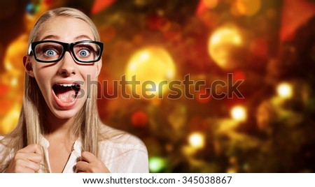 Close up portrait young blonde business woman, looking shocked, surprised in full disbelief isolated against Christmas or New Year tree. Positive human emotions, facial expressions, feeling, reaction. - stock photo