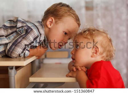 Close up portraits of two little brothers at home. Cute siblings. - stock photo