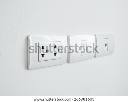 Close up power outlet and telephone outlet and computer outlet in a socket  - stock photo
