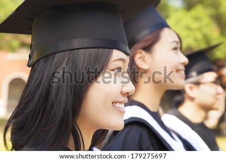 close-up pretty female university graduate  at ceremony - stock photo