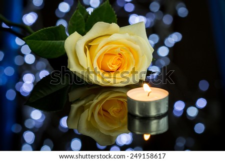 Close up Pretty Red Rose, Lighted Candle and a Jewelry Present Gift Box on Top of Glossy Table - stock photo