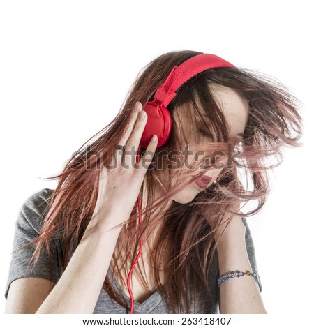 Close up Pretty Young Woman Enjoying the Music from Headphone, Isolated on White Background. - stock photo