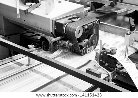 Close up printing machine during production - stock photo