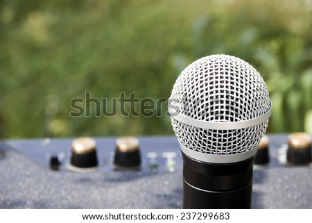 close-up professional microphone at loudspeaker - stock photo