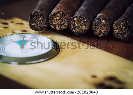 close-up quality cigar and humidor with hygrometer - stock photo