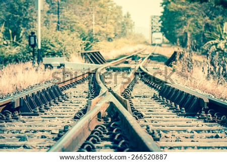 Close up railway track crossing before metal bridge - stock photo