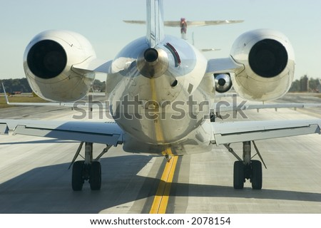 Close up rear view of jet - stock photo