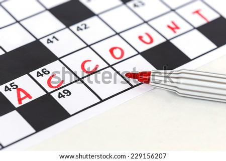 Close up red marker on Crossword - Account - stock photo