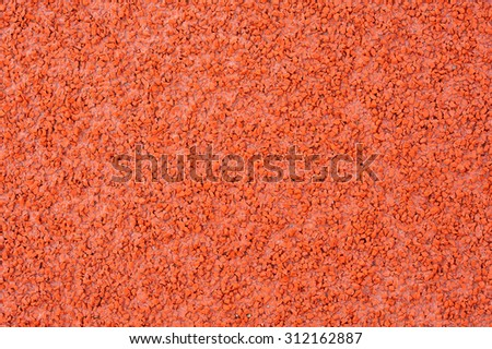 Close up red racetrack texture - stock photo