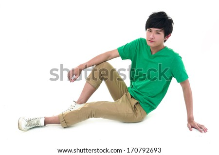 Close up relaxed man sitting on the floor - stock photo