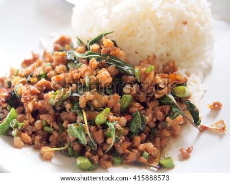 Close up Rice topped with stir fried pork and basil - stock photo