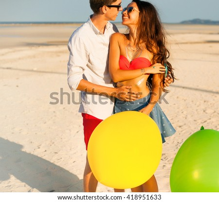 Close up romantic beauty portrait of happy hipster couple in love hugs and having fun, evening sunlight, stylish sunglasses,emotions, joy, youth, sunny colors,hugs and kisses, vintage filer,sunset  - stock photo