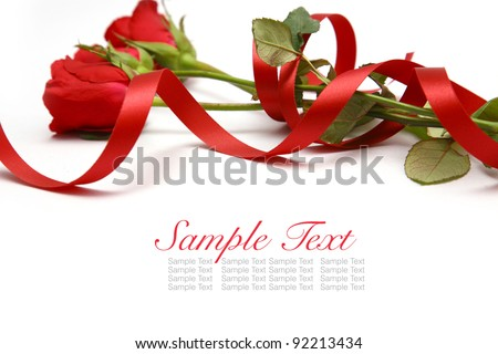 close up  roses and red ribbon on white. - stock photo