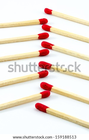 Close-up row of red matchstick on isolated background - stock photo