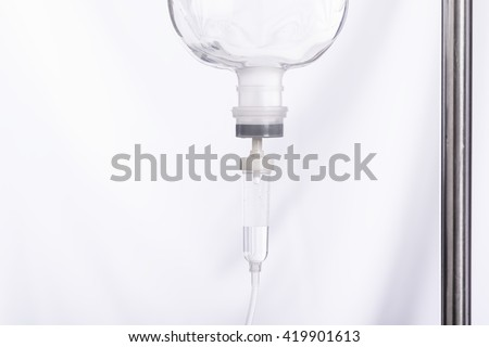 Close up saline IV drip for patient in hospital with copy space - stock photo