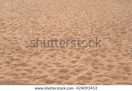 Close up sand texture background of a beach in the summer. - stock photo