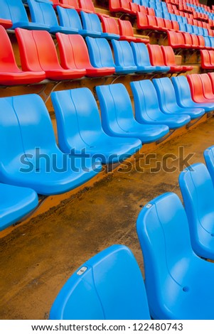 close up seat, red and blue seat on stadium steps bleacher - stock photo