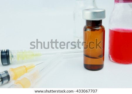 Close -up Selective focus vials and  syringes with blurred background  in the hospital. : medication,vaccine, drugs, blood, laboratory. - stock photo