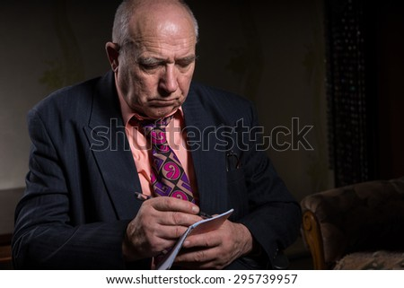Close up Senior Bald Businessman in Business Suit, Taking Down Notes with Serious Facial Expression. - stock photo