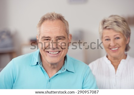 Close up Senior Husband Beside his Pretty Wife, Looking at the Camera with Happy Facial Expression. - stock photo