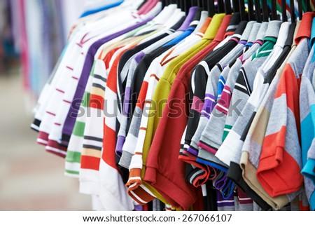 Close-up shirt and clothing apparel at shopping store - stock photo